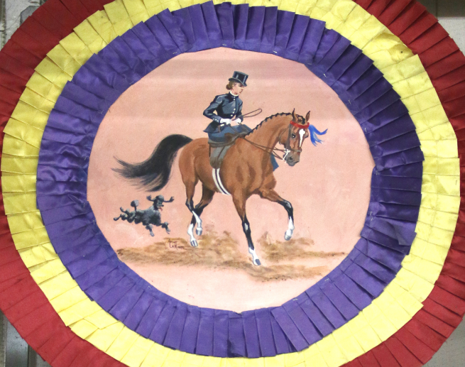 Horse Show prize ribbon with painting of rider on it